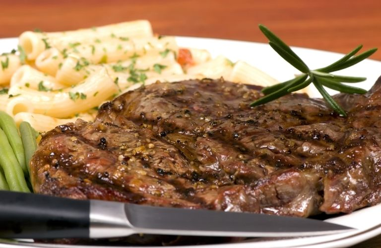 Steak and pasta served together